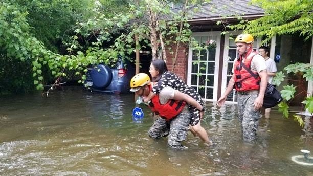 Texas National Guard soldiers aid stranded residents in heavily flooded areas from the storms of Hurricane Harvey in Houston, Texas, U.S., August 27, 2017.    Lt. Zachary West, 100th MPAD/Texas Military Department/Handout via REUTERS ATTENTION EDITORS - THIS IMAGE WAS PROVIDED BY A THIRD PARTY - RTX3DK9D