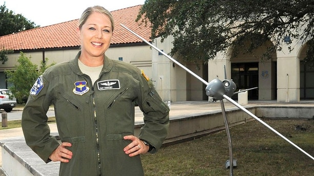 Tech. Sgt. Courtney is photographed at the 558th Flying Training Squadron at Joint Base San Antonio-Randolph, Texas, July 26, 2017. She completed undergraduate remotely piloted aircraft training August 4 and is the first Air Force enlisted female to train as a pilot. Name badge is blurred due to Air Force limits on disclosure of identifying information for RPA operators.  (U.S. Air Force illustration/Tech. Sgt. Ave I. Young)