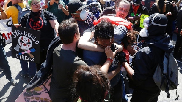 "Demonstrators clash during a free speech rally Sunday, Aug. 27, 2017, in Berkeley, Calif. Several thousand people converged in Berkeley Sunday for a ""Rally Against Hate"" in response to a planned right-wing protest that raised concerns of violence and triggered a massive police presence. Several people were arrested for violating rules against covering their faces or carrying items banned by authorities. (AP Photo/Marcio Jose Sanchez)"