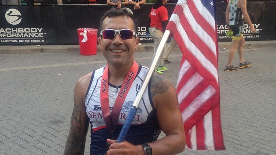 Former Marine Sgt. Michael Mendoza after finishing an Ironman race in Louisville, Kentucky.