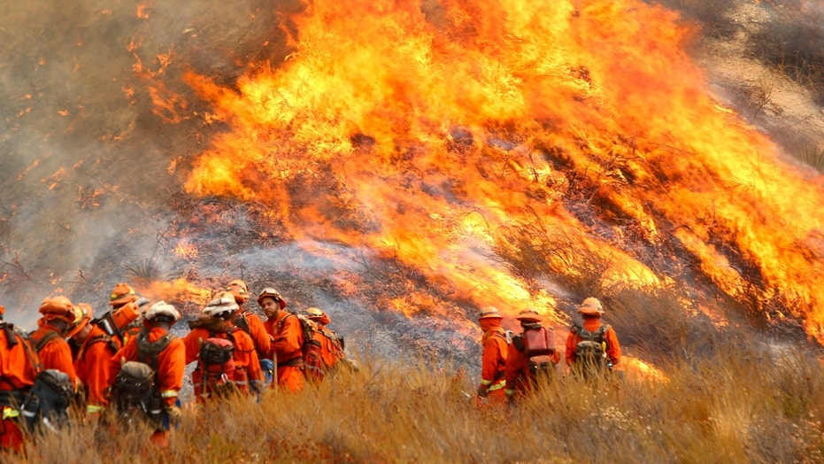 California state firefighters battle the so-called La Tuna brushfire in Burbank, Calif., Sept. 2, 2017.