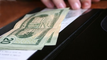 Money and receipt being placed on the payment binder for payment of a meal.