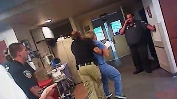 In this July 26, 2017, frame grab from video taken from a police body camera and provided by attorney Karra Porter, nurse Alex Wubbels is arrested by a Salt Lake City police officer at University Hospital in Salt Lake City. The Utah police department is making changes after the officer dragged Wubbels out of the hospital in handcuffs when she refused to allow blood to be drawn from an unconscious patient. (Salt Lake City Police Department/Courtesy of Karra Porter via AP)