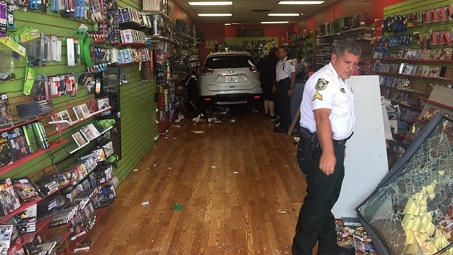 A vehicle crashed into R.U. Game in northern Tampa Friday.