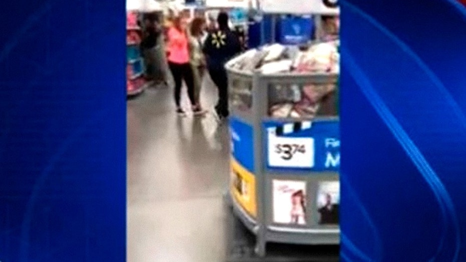 Image from cellphone video shot after woman pulled out a loaded gun at Michigan Walmart