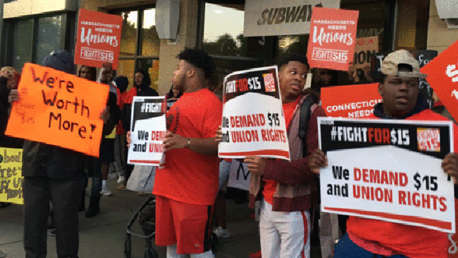 Workers demonstrate for a $15 minimum wage in Boston on Monday, Sept. 4, 2017.