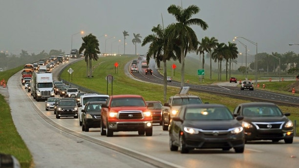 Traffic is seen heading North along the Florida Turnpike near Homestead, Fla.,  as tourists in the Florida Keys leave town on Wednesday, Sept. 6, 2017. Heavy rain and 185-mph winds lashed the Virgin Islands and Puerto Rico's northeast coast Wednesday as Hurricane Irma roared through Caribbean islands on its way to a possible hit on South Florida.  (Al Diaz/Miami Herald via AP)