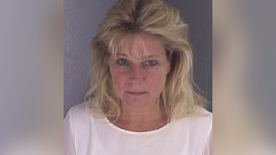 Teresa Jo Burchfield was allegedly caught in the backseat of her car with an inmate.