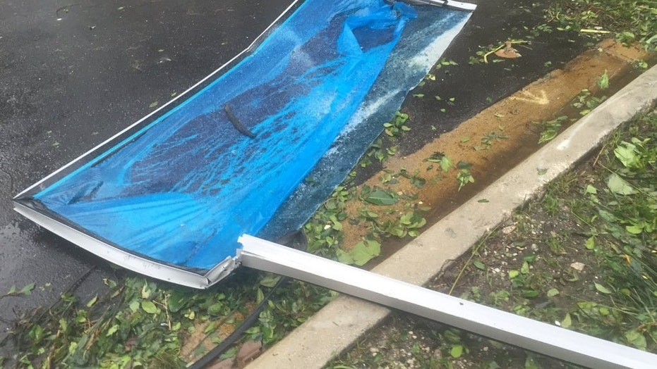 Glass panels fell from a high-rise building in Miami on Sunday after Hurricane Irma pushed its way through the city.