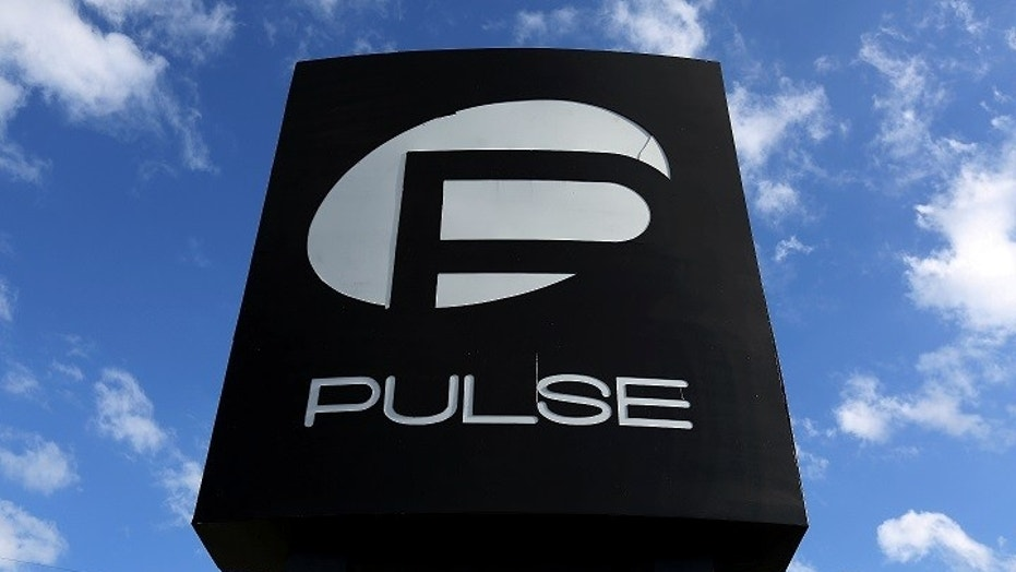 The Pulse nightclub sign was protected by workers Saturday in preparation for Hurricane Irma. The club was the site of the horrific mass shooting in June 2016.