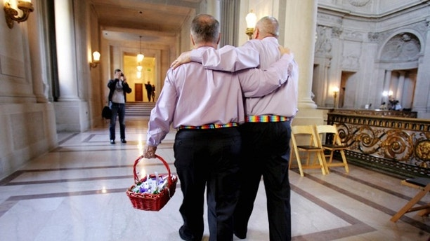 FILE 2008: A male couple inside San Francisco City Hall as they prepare to get married. San Francisco, Calif.