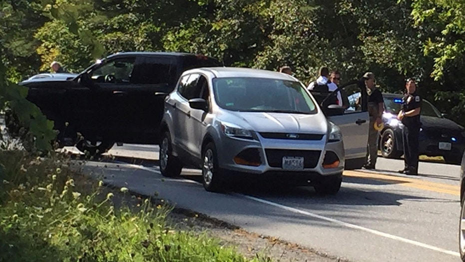 Police surround the suspect's car near Dartmouth-Hitchcock Medical Center in Lebanon, N.H.