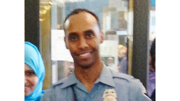 FILE - In this May 2016 image provided by the City of Minneapolis, police officer Mohamed Noor poses for a photo at a community event welcoming him to the Minneapolis police force. Noor fatally shot Justine Damond, an Australian native on July 15, 2017. Prosecutors announced Tuesday, Sept. 12, 2017, that the Minnesota Bureau of Criminal Apprehension have finished their investigation and have handed the case over to prosecutors for possible charges. (City of Minneapolis via AP, File)