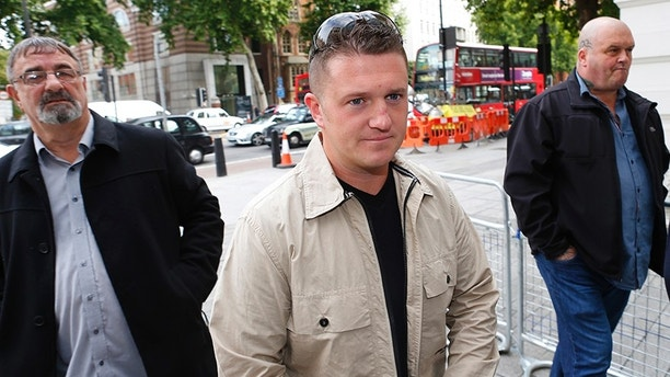 English Defence League leader Tommy Robinson (C) arrives at Westminster Magistrates' Court in London September 11, 2013. Robinson is charged under his real name Stephen Yaxley-Lennon, with obstructing police during an attempt to walk to Woolwich Barracks following the killing of Drummer Lee Rigby. REUTERS/Andrew Winning  (BRITAIN) - LM1E99B0P1901