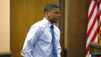 FILE - In this March 17, 2013, file photo, Ma'Lik Richmond walks toward the victim and her family to apologize after he and co-defendant Trent Mays were found delinquent on rape and other charges after their trial in juvenile court in Steubenville, Ohio. Richmond will be part of the Youngstown State football team this year but won't be allowed to play in any games, the school said Wednesday, Aug. 9, 2017, in responding to criticism surrounding his participation. Richmond served about 10 months in a juvenile lockup after being convicted with another Steubenville High School football player of raping a 16-year-old girl during an alcohol-fueled party in 2012. The case brought international attention to the eastern Ohio city of 18,000 and led to allegations of a cover-up to protect the football team. (AP Photo/Keith Srakocic, Pool, File)