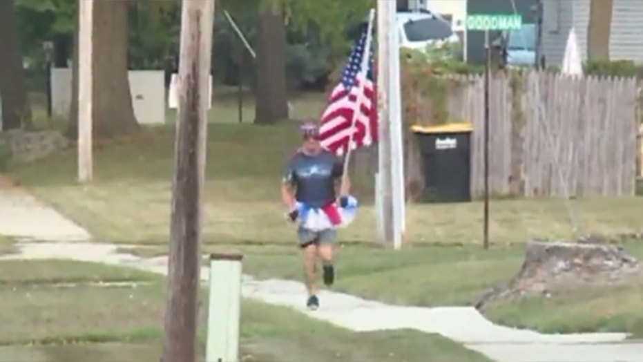 Robert Woldhuis, who goes by the nickname 'Tutuman,' wears a tutu and carries the American flag while running every Friday in Wyoming, Mich.