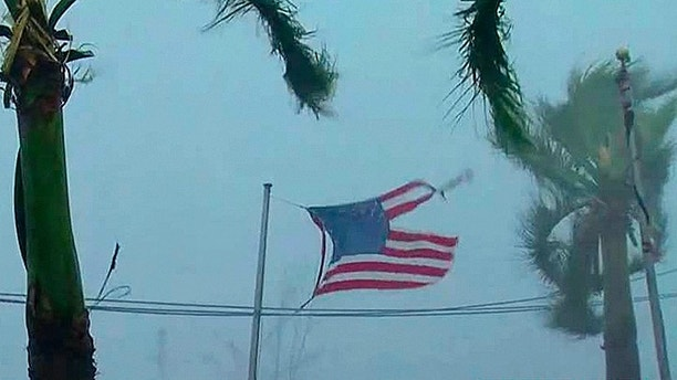 A flag ripped apart by the wind in San Juan, Puerto Rico, Wednesday.  FOX News