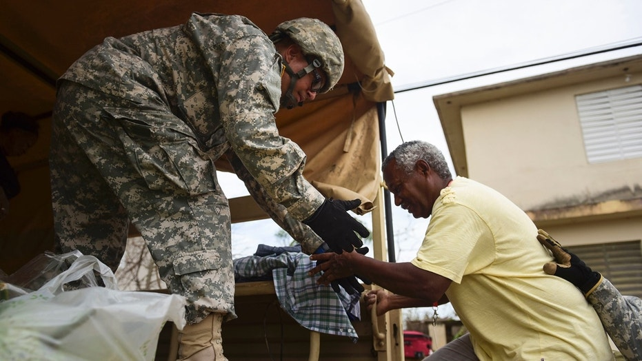 National Guard personnel evacuate Toa Ville resident Luis Alberto Martinez after the passing of Hurricane Maria, in Toa Baja, Puerto Rico, Sept. 22, 2017.