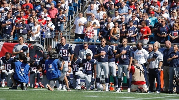 Sep 24, 2017; Foxborough, MA, USA; Members of the New England Patriots kneel for the national anthem before the start of the game against the Houston Texans at Gillette Stadium. Mandatory Credit: David Butler II-USA TODAY Sports - 10303282