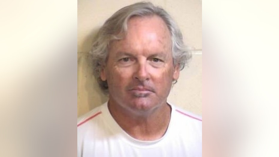 "Peter Samhammer, 64, was arrested by police after he allegedly choked students with a jump rope as a form of ""discipline."""