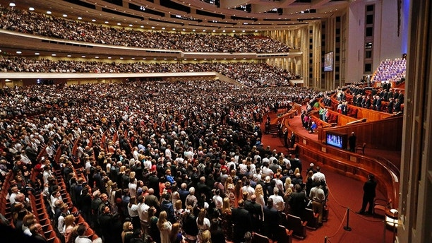 People attend the morning session of the two-day Mormon church conference Saturday, Sept. 30, 2017, in Salt Lake City. (AP Photo/Rick Bowmer)