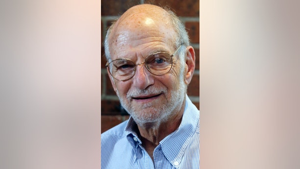 Michael Rosbash smiles during an interview at his home, Monday, Oct. 2, 2017, in Newton, Mass. Rosbach is one of the Americans awarded this year's Nobel Prize in physiology or medicine for discovering the molecular mechanisms that control humans' circadian rhythm. (AP Photo/Bill Sikes)