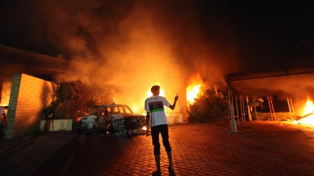 The U.S. Consulate in Benghazi is seen in flames during a protest by an armed group said to have been protesting a film being produced in the United States September 11, 2012. An American staff member of the U.S. consulate in the eastern Libyan city of Benghazi has died following fierce clashes at the compound, Libyan security sources said on Wednesday. Armed gunmen attacked the compound on Tuesday evening, clashing with Libyan security forces before the latter withdrew as they came under heavy fire. REUTERS/Esam Al-Fetori (LIBYA - Tags: POLITICS CIVIL UNREST) - RTR37UVB