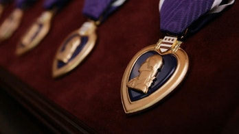 Purple Heart medals, bearing the image of Gen. George Washington, are seen prior to the start of a ceremony at Walter Reed Army Medical Center in Washington, Friday, April 6, 2007. (AP Photo/Charles Dharapak)