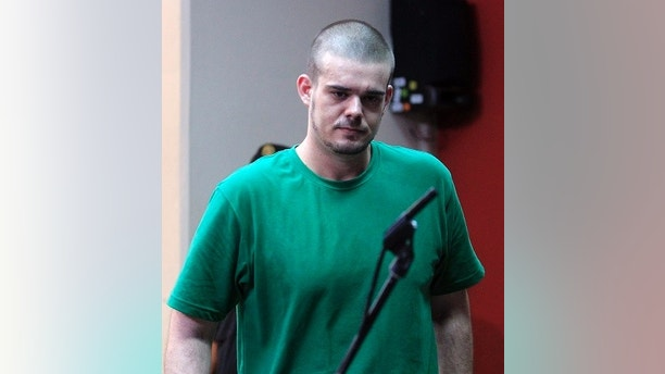 Dutch citizen Joran Van der Sloot walks inside the courtroom during the reading of his verdict, in the Lurigancho prison in Lima January 13, 2012. Van der Sloot was sentenced to 28 years in prison by a Peruvian court on Friday for killing Stephany Flores in Lima in 2010, exactly five years after 18-year-old Alabama native Natalee Holloway disappeared on the island of Aruba after spending time with him.       REUTERS/Pilar Olivares (PERU - Tags: CRIME LAW POLITICS) - GM1E81E04XT01