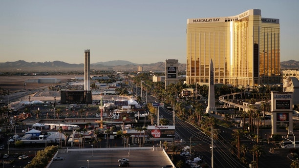 The Mandalay Bay resort and casino, right, overlooks an outdoor festival grounds across the street, left, Tuesday, Oct. 3, 2017, in Las Vegas. Authorities said Stephen Craig Paddock broke the windows on the casino and began firing with a cache of weapons, killing dozens and injuring hundreds at a music festival at the grounds. (AP Photo/John Locher)