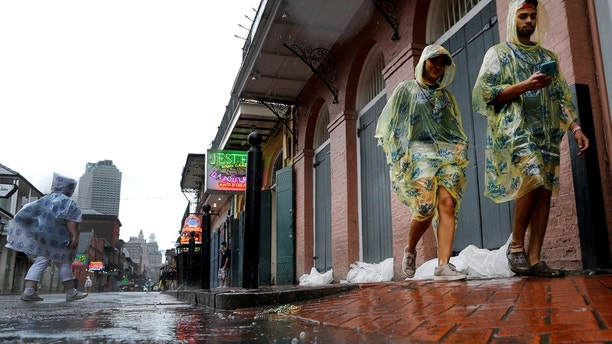 Tourists walk down Bourbon Street as Hurricane Nate approaches the U.S. Gulf Coast in New Orleans, Louisiana, U.S. on October 7, 2017. REUTERS/Jonathan Bachman - RC19ED9B6070