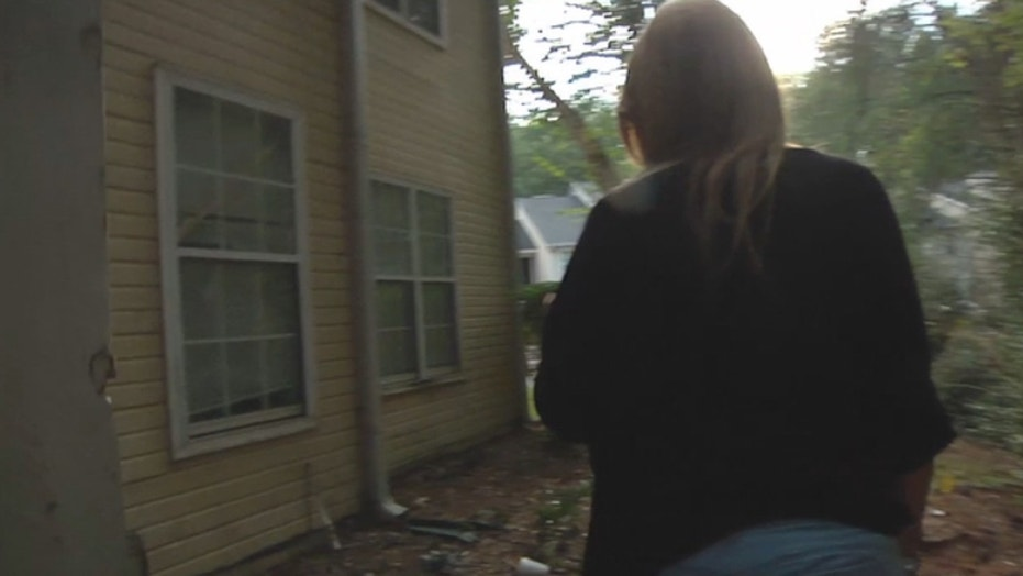 Leona Word shows where the intruder entered her home.