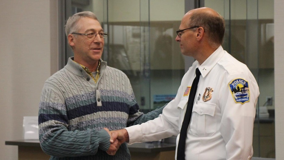 Earl Melchert, who found missing teenage girl, meets with Alexandria Police Chief Rik Wyffels.