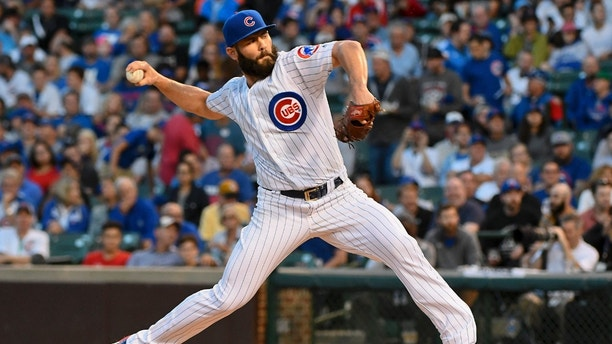 Aug 29, 2017; Chicago, IL, USA; Chicago Cubs starting pitcher Jake Arrieta (49) delivers against the Pittsburgh Pirates in the first inning at Wrigley Field. Mandatory Credit: Matt Marton-USA TODAY Sports - 10246305