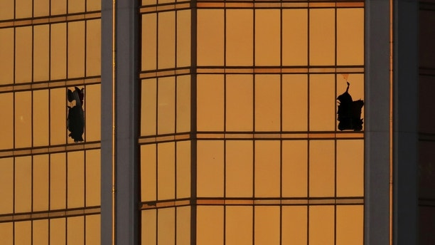 Morning light reflects off the Mandalay Bay hotel and the broken windows where shooter Stephen Paddock conducted his shooting spree from the 32nd floor in Las Vegas, Nevada, U.S., October 3, 2017. REUTERS/Mike Blake - RC1233E95D00