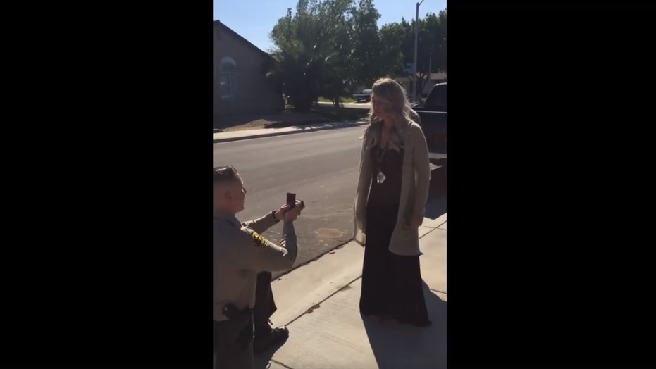 Deputy Kevin Bowes' fellow deputies pulled over his girlfriend for the proposal. (Palmdale Sheriff's Station)