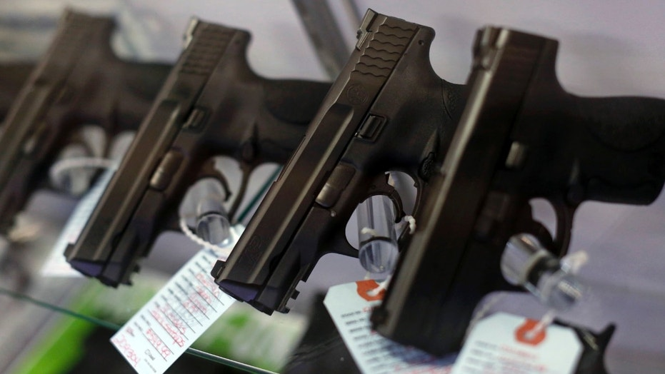 Handguns are displayed for sale at Metro Shooting Supplies in Bridgeton, Mo., Nov. 13, 2014.