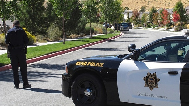 Reno police block off the street a half-block away from where authorities searched a home owned by Stephen Paddock on Monday, Oct. 2, 2017, in Reno, Nev. Paddock opened fire on a crowd at a country music concert on the Las Vegas Strip on Sunday. (AP Photo/Scott Sonner)