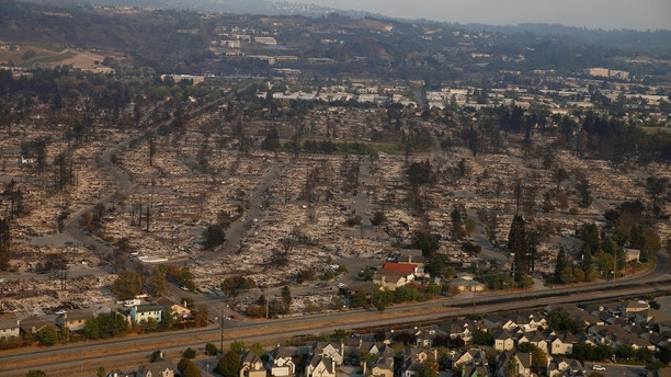 An aerial view of properties destroyed by the Tubbs Fire is seen in Santa Rosa, California, U.S., October 11, 2017. REUTERS/Stephen Lam - RC1BA3B2B450