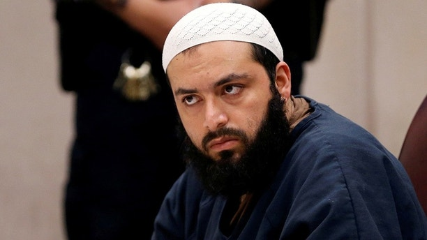 FILE PHOTO: Ahmad Khan Rahimi, an Afghan-born U.S. citizen accused of planting bombs in New York and New Jersey, appears in Union County Superior Court for a hearing in Elizabeth, New Jersey, U.S., on May 15, 2017. REUTERS/Mike Segar/File Photo - RC14BCDC5760