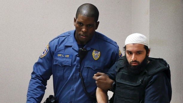 Ahmad Khan Rahimi, the man accused of setting off bombs in New Jersey and New York in September, injuring more than 30 people, is led into court Tuesday, Dec. 20, 2016, in Elizabeth, N.J. (AP Photo/Mel Evans)
