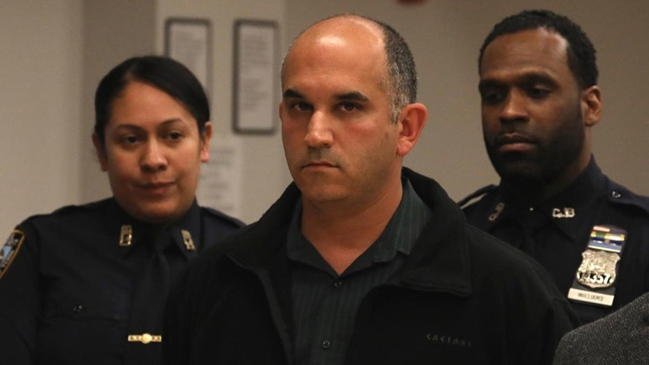 NYPD Officer Adam Fridson, 43, center, has been charged with flashing two girls in the Bronx.