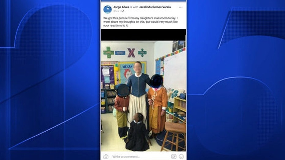 Photo of black girl held by leashes at MA school sparks complaints