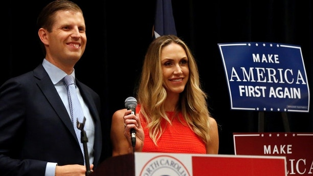 Donald Trump's son Eric Trump and his wife Lara Yunaska speak with members of the North Carolina delegation at their breakfast in Warrensville Heights, Ohio.  REUTERS/Shannon Stapleton - RTSJ1V4