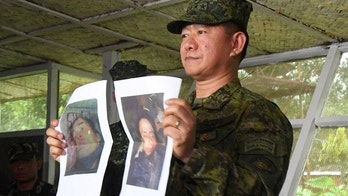 ATTENTION EDITORS - VISUAL COVERAGE OF SCENES OF DEATH Chief of Staff of the Armed Forces of the Philippines Eduardo Ano shows reporters a picture of killed Abu Sayyaf Isnilon Hapilon and Omar Maute, leader of the Maute-Islamic State group, during a news conference at the military headquarters in Marawi City, Philippines October 16, 2017. REUTERS/Froilan Gallardo TEMPLATE OUT - RC11768A8480