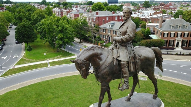 FILE - This Tuesday June 27, 2017, file photo shows the statue of Confederate General Robert E. Lee that stands in the middle of a traffic circle on Monument Avenue in Richmond, Va. Proposed rules for political rallies at Richmond's Robert E. Lee statue call for limiting crowd size and banning guns. (AP Photo/Steve Helber, File)