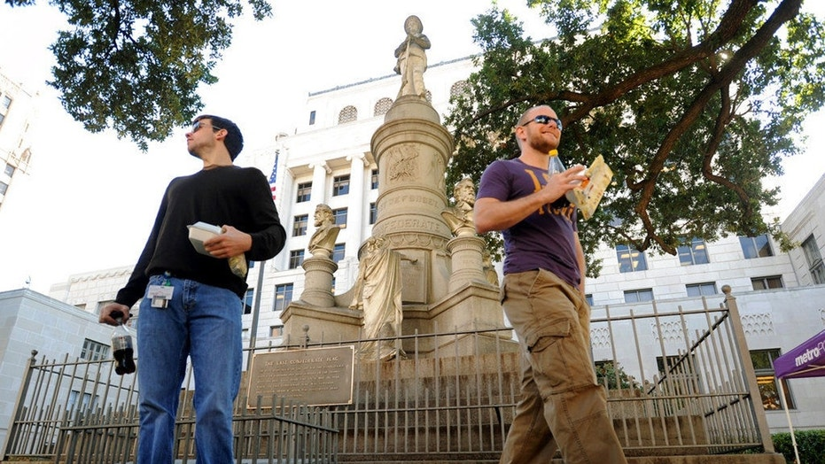 Sean Bordelon, left, and Raphiel Heard pause after reading the inscription on a Confederate soldier's monument in front of the Caddo Parish Courthouse in Shreveport on Nov. 4, 2011.