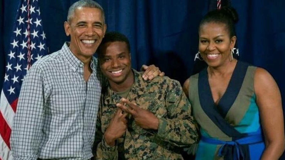 Sgt. William Brown, center, stands with former President Barack Obama and Michelle Obama.