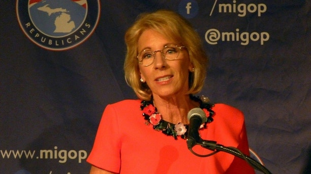 "Education Secretary Betsy DeVos speaks on Friday, Sept. 22, 2017 at the Mackinac Republican Leadership Conference on Mackinac Island, Mich. DeVos said Obama-era guidance on investigating campaign sexual assaults ""didn't work for anyone."" (AP Photos/David Eggert)"