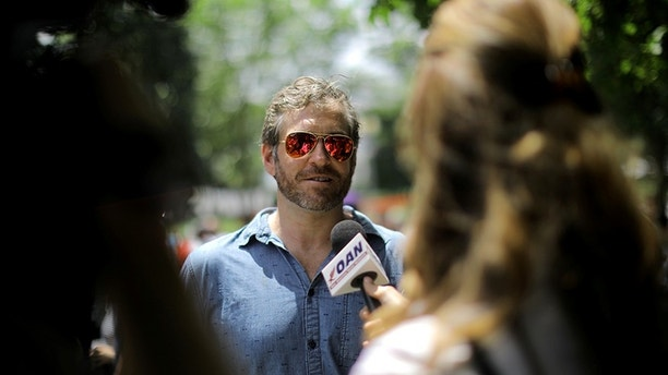 Mike Cernovich attends at a rally about free speech outside of the White House in Washington, U.S., June 25, 2017. REUTERS/Carlos Barria - RC1FB9CF2040